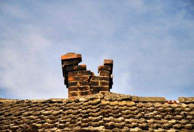 Rusty broken chimney on the blue sky stock vector