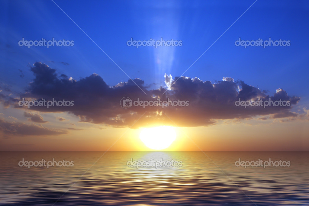 Sunset and sun behind the cloud