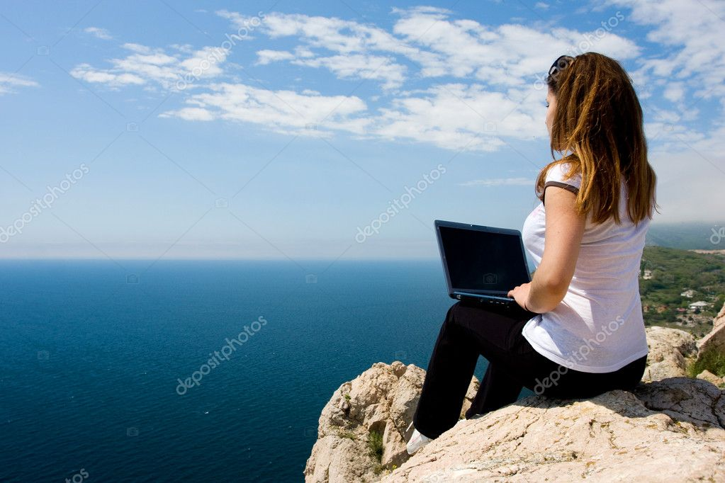 Woman with laptop and nature