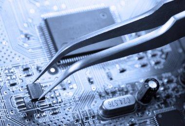 Assembling a circuit board stock vector