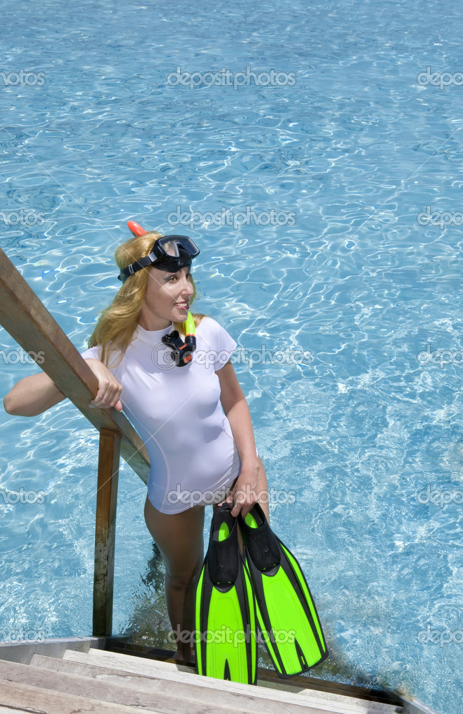 Woman stands with equipment for Snorkel