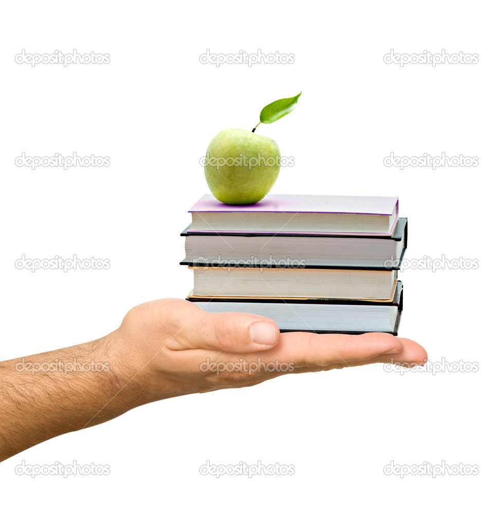Books with apple in hand as a gift of education