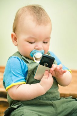 Baby playing with a cell phone