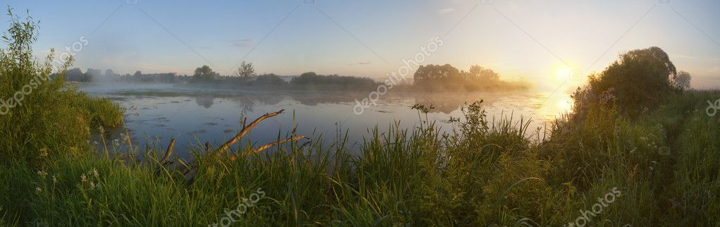 Dawn in a fog on the river.