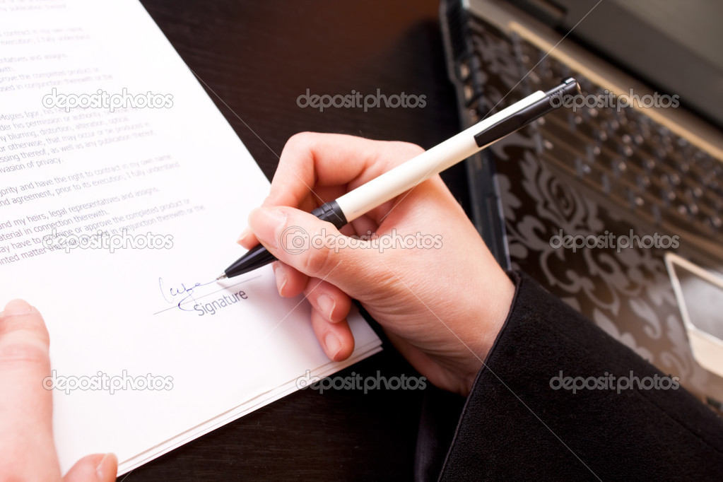Signing A Business Document  Stock Photo  Luckybusiness