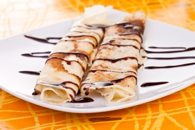 Pancakes with chocolate syrup