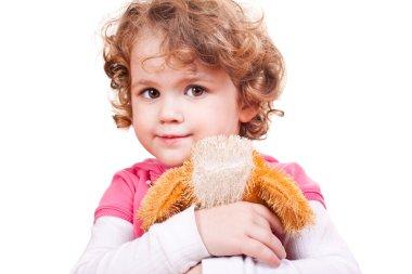 Little girl hugging toy dog