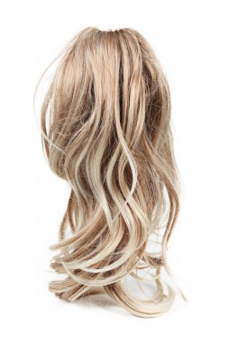 Wig of long blond hair isolated on white