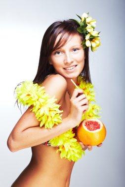 Beautiful girl drinking grapefruit