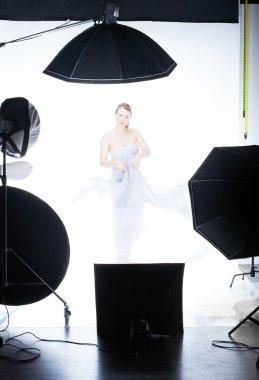Young beautiful model posing in studio