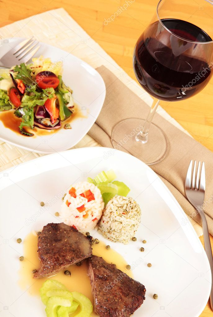 Gourmet meal with red wine