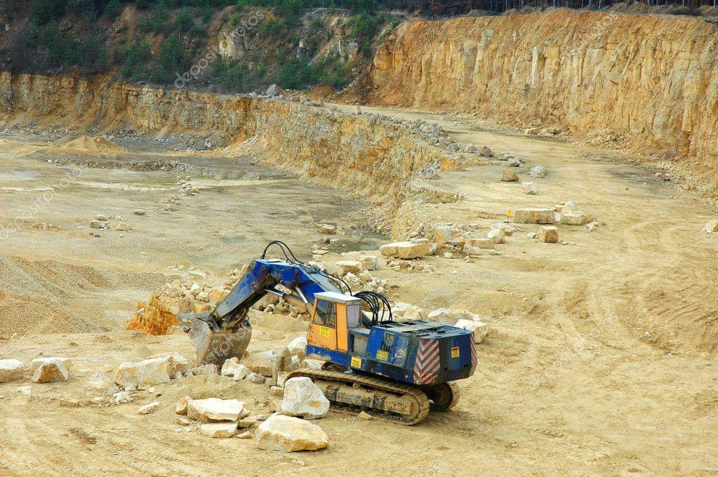 Digger in quarry