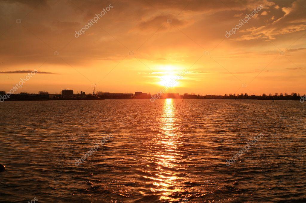 Sunset over a Dutch canal near Sneek.