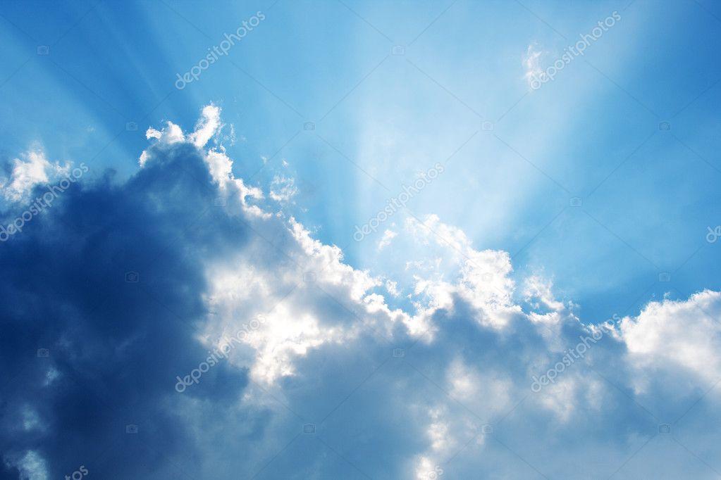 Summer sky with sun-rays