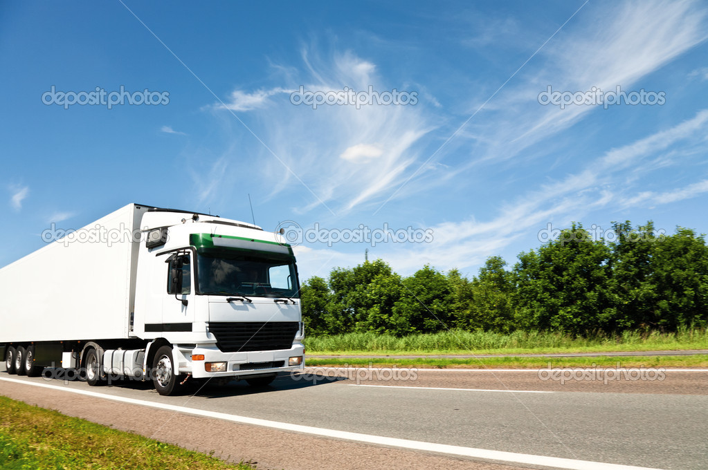 Truck driving on country road