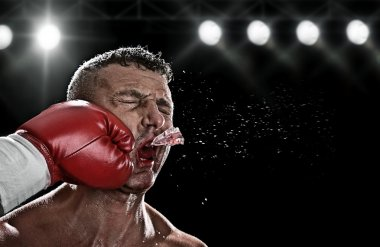 Low key portrait of boxer getting knocked out stock vector