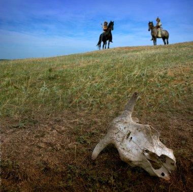 Horsemen archers in steppe wit cow skull