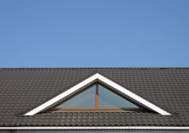 Brown tile roof construction, blue sky