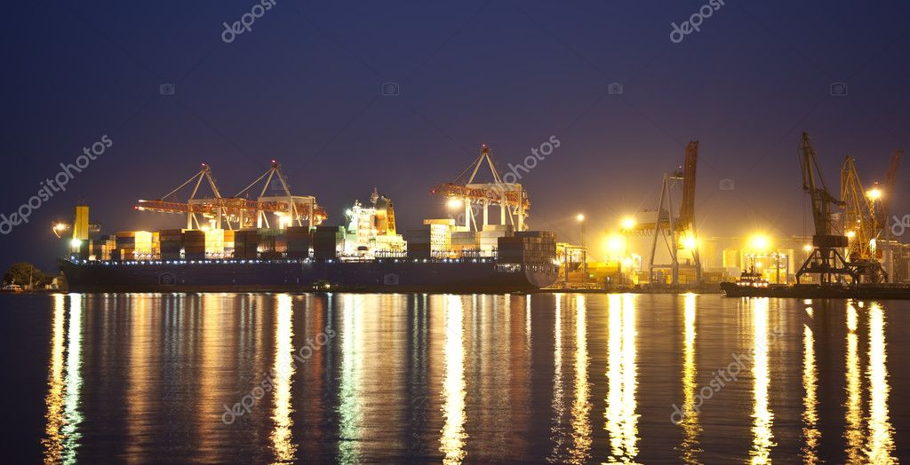 Cargo ship in the port at night