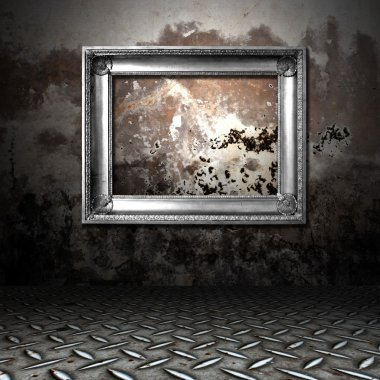 Silver frame in a dark grungy room
