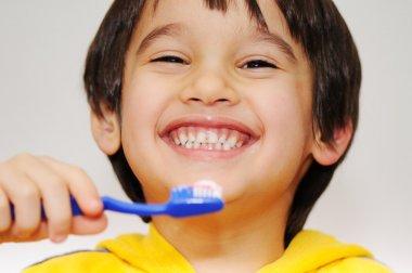 Boy cleans teeths