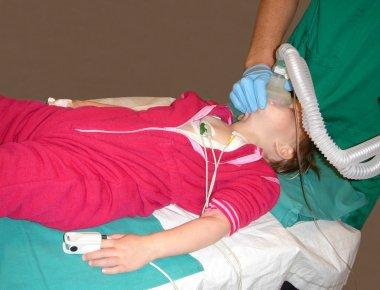 Little child being sedated
