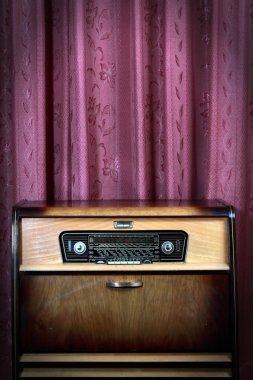 Old vintage radio on red background