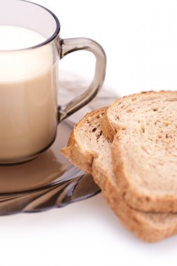 Bread and cup of milk (blurred)