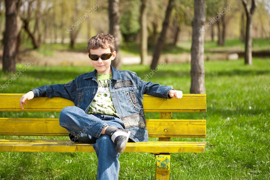 Cool kid sitting on bench