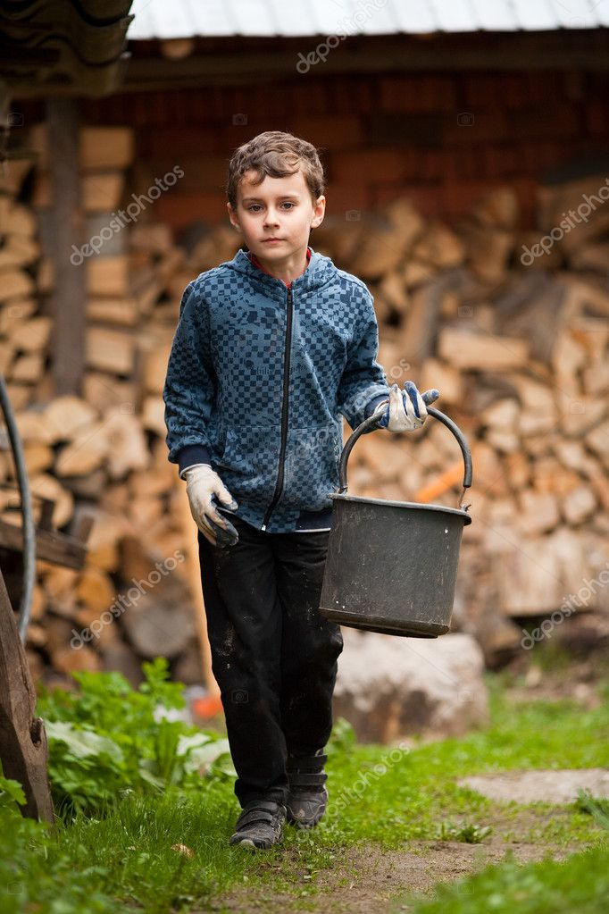 Child with a bucket