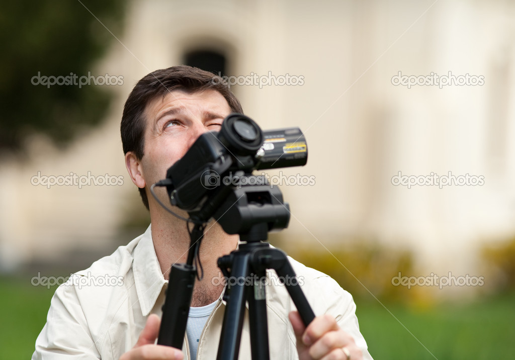 Caucasian man filming