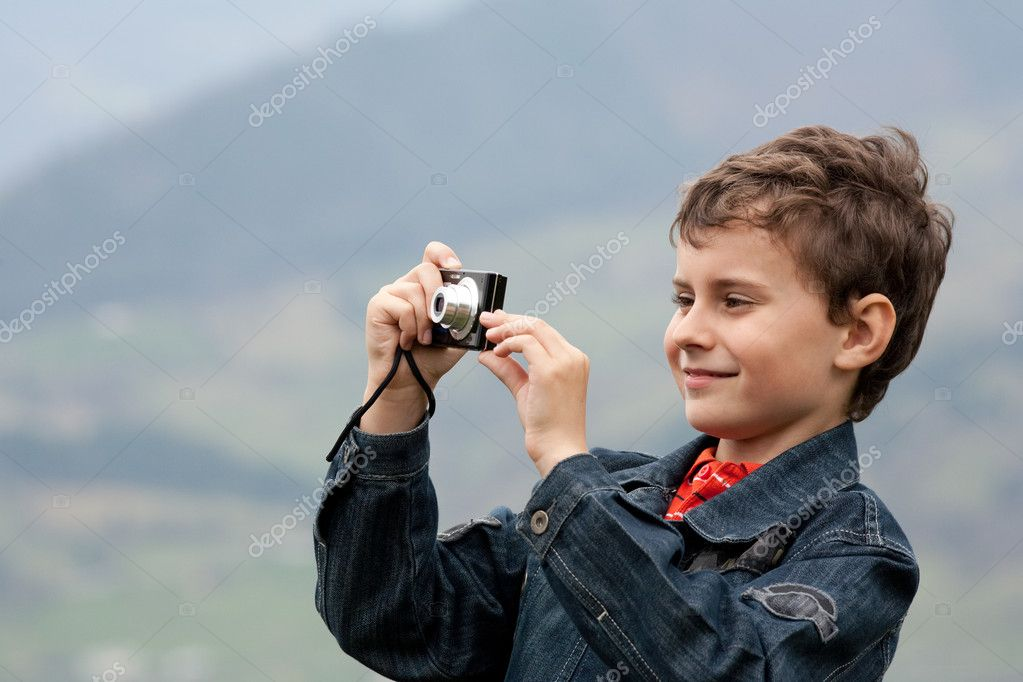 Cute kid taking photos