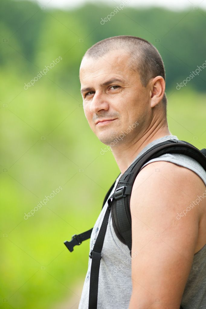 Man hiking into the woods