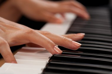 Piano player closeup on hands