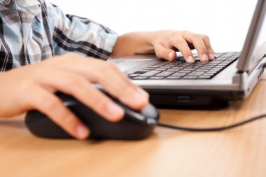 Kid using mouse and keyboard