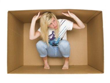 Woman inside a Cradboard Box