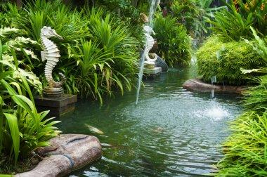 Tropical zen garden view with fountain and green plants. stock vector