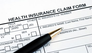Filling the health insurance claim form with a pen stock vector
