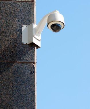 Security / surveillance camera against a