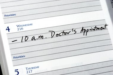 Mark the doctor appointment in the day planner