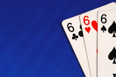 Three of the number six cards concepts of devil isolated on blue