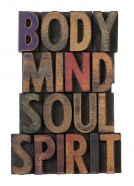 Body, mind, soul, spirit in wood type