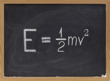 Kinetic energy equation on blackboard