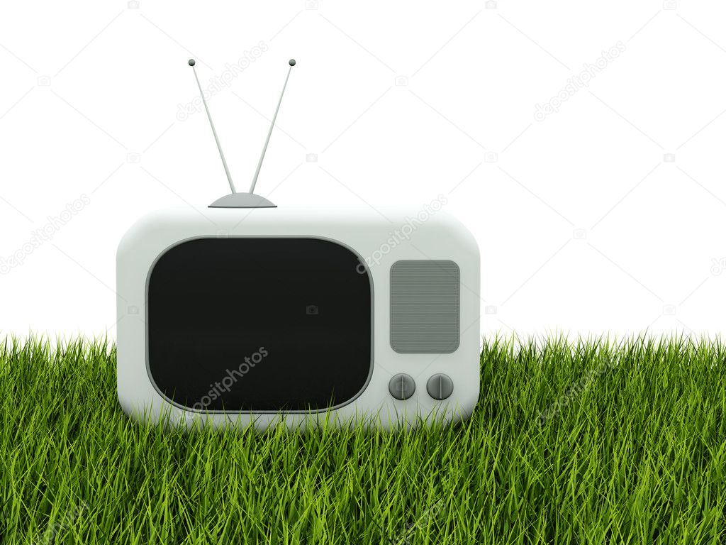 TV on green grass isolated on white