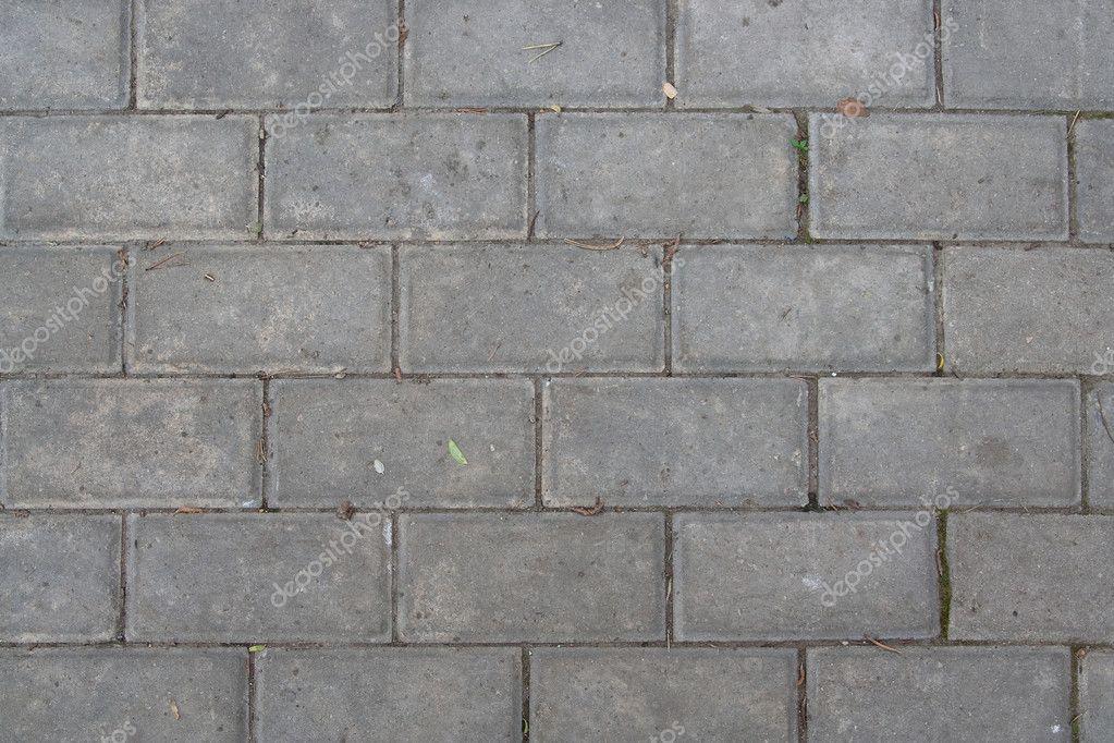 Il marciapiede è stato pavimentato con piastrelle u foto stock