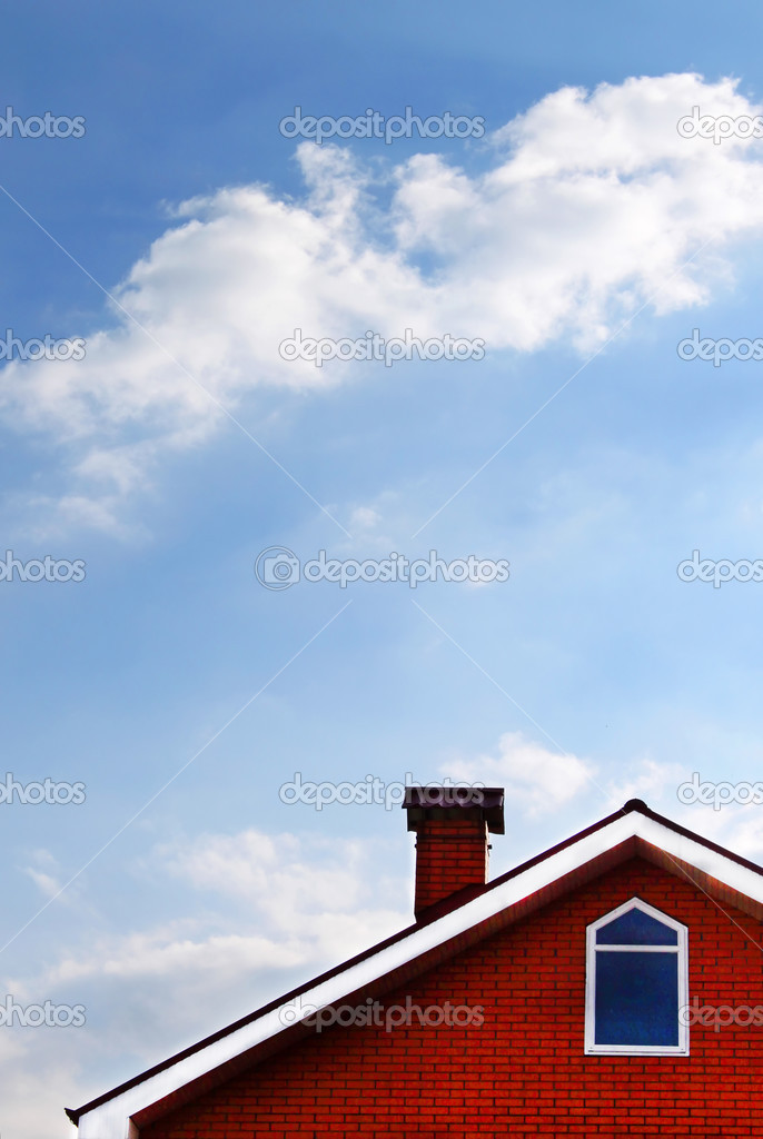 House and blue sky with cloud