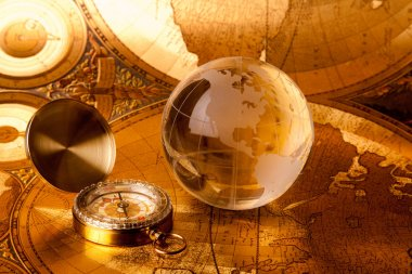 Gold globe and compass