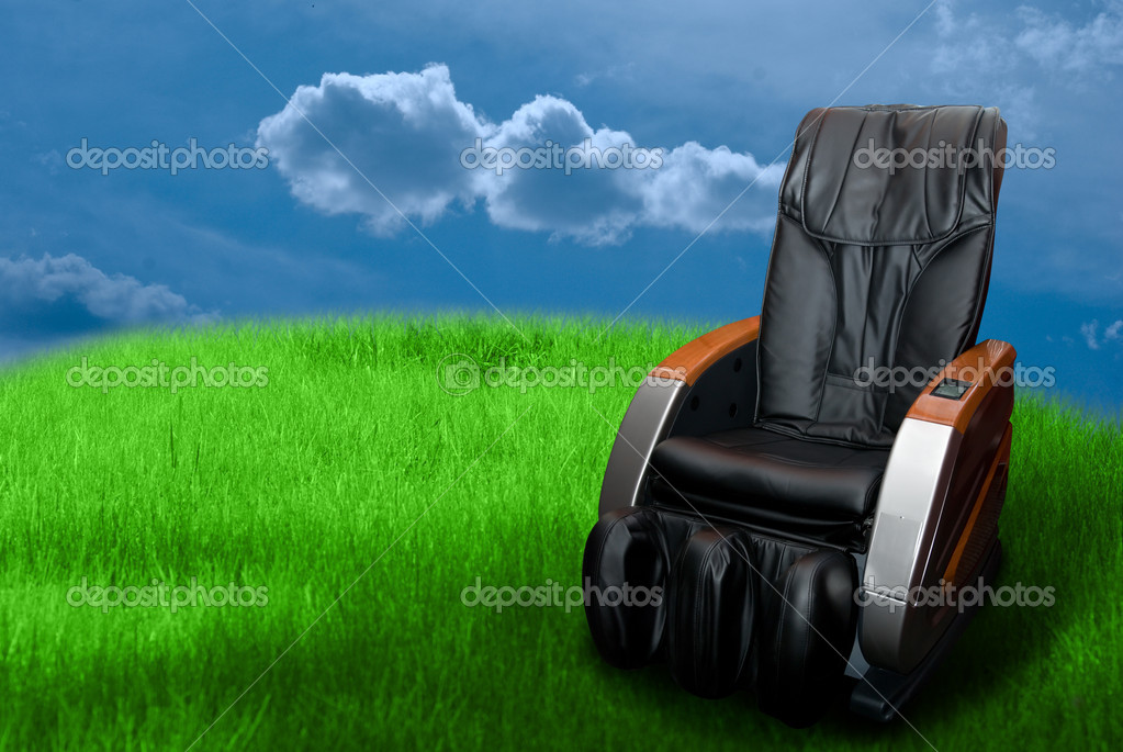 Massage arm-chair on the green grass