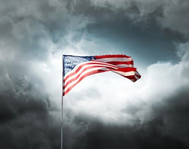 American flag on a cloudy dramatic sky