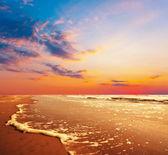 moře při západu slunce